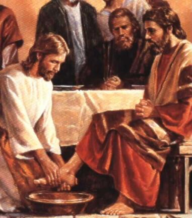 Jesus washes the feet of the apostles.